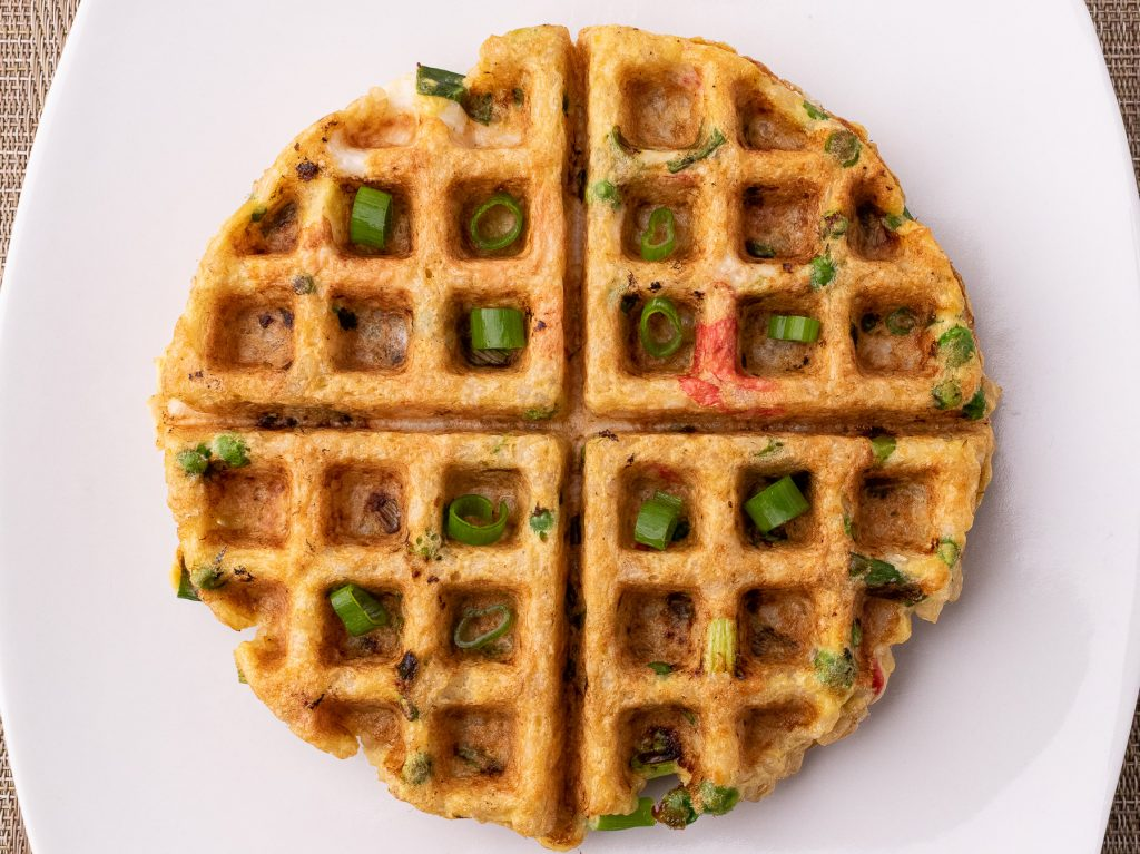 Fried rice waffle topped with green onions