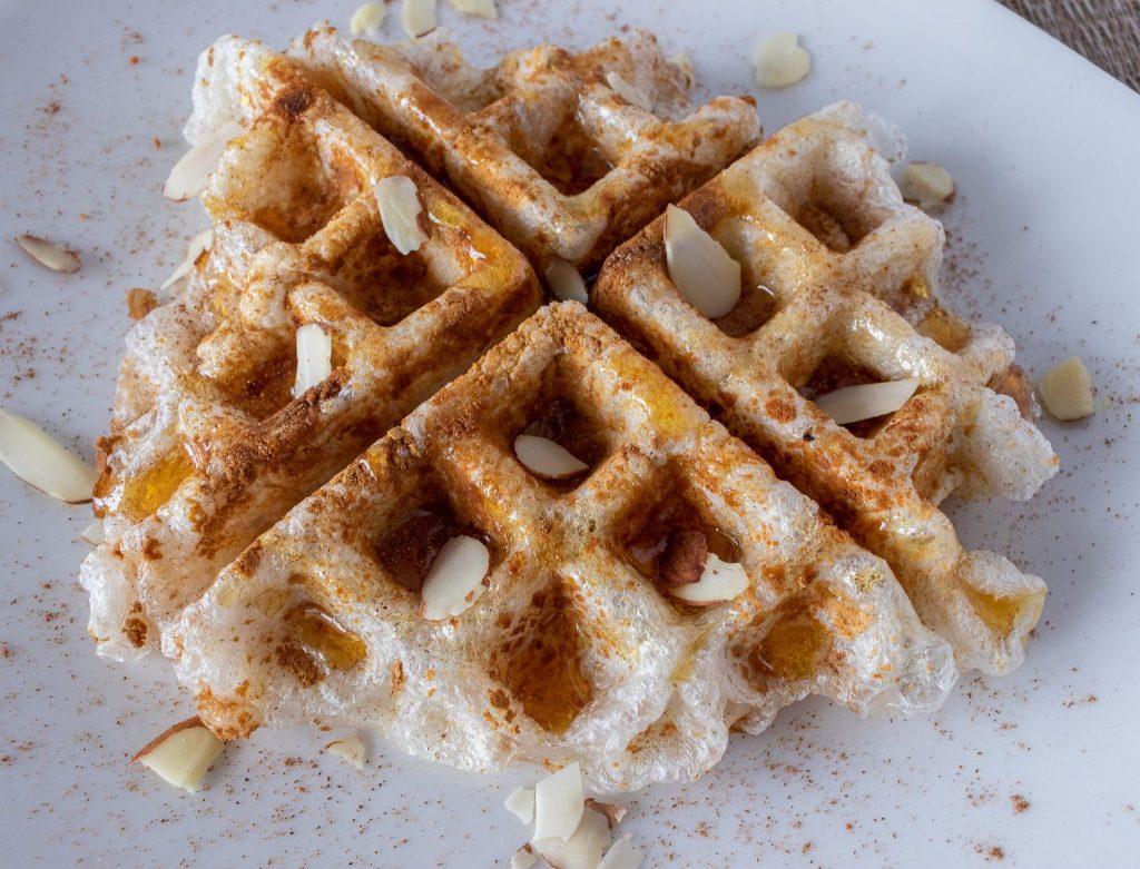 Injeolmi waffle with honey, cinnamon, and sliced almonds